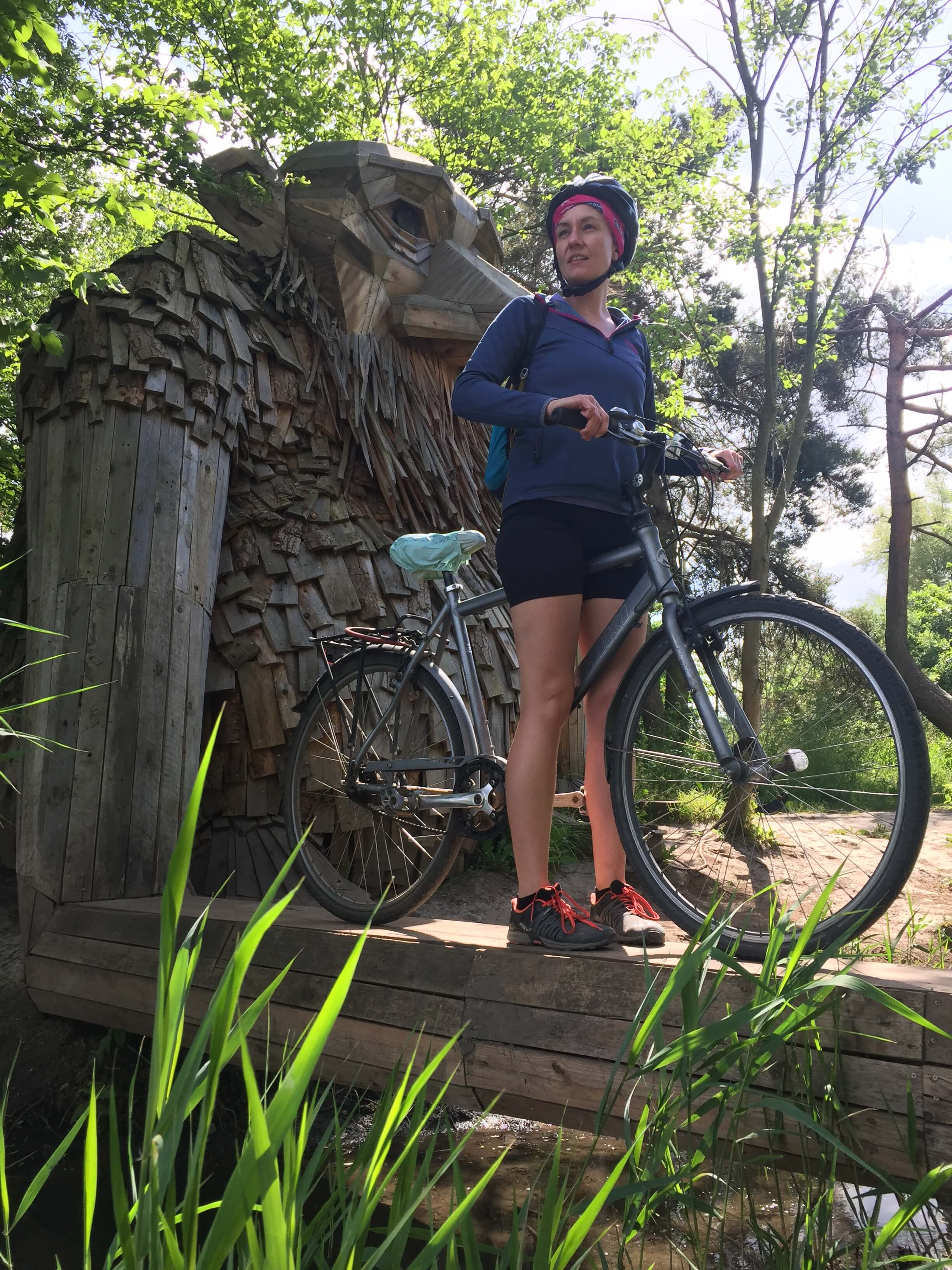 Tracy riding a bicycle in nature